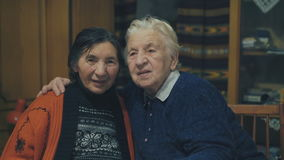 Portrait of two very old women sitting in embraces at the holiday table. 4K stock video footage