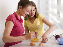 Portrait of two woman friends cooking Stock Image