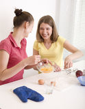 Portrait of two woman friends cooking Royalty Free Stock Image