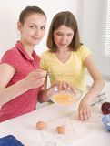 Portrait of two woman friends cooking Stock Photography