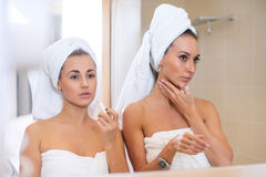 Portrait of two women doing make up together in morning Royalty Free Stock Photography