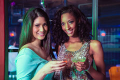 Portrait of two women having cocktail Stock Photos