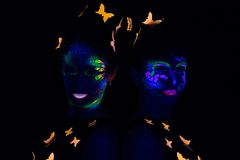 Portrait of two women with luminous make up Royalty Free Stock Images