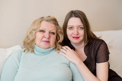 Portrait of two women, mother and daughter. Royalty Free Stock Photo
