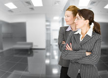 Portrait of two women in office clothes Royalty Free Stock Image
