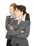 Portrait of two women in office clothes. On a white background Royalty Free Stock Photography