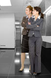 Portrait of two women in office clothes Royalty Free Stock Photos