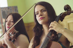 Portrait of two women playing music Stock Photography