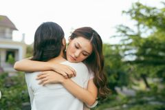 Portrait two women. Sad unhappy young woman being consoled by he stock images