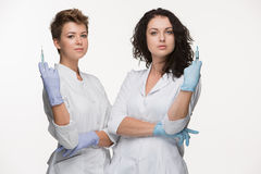 Portrait of two women surgeons showing syringes Royalty Free Stock Photography