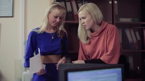 Portrait of two women working in the office. Portrait of two women working with documents in the office stock footage
