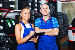 Portrait of two  workers in protective overalls Royalty Free Stock Photos