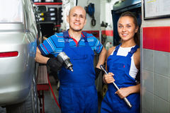 Portrait of two  workers in protective overalls Stock Images