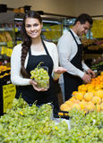 Portrait of two workers with seasonal fruits Stock Photo