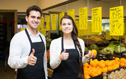 Portrait of two workers with seasonal fruits Royalty Free Stock Images