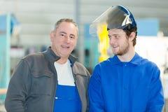 Portrait two workmen one wearing visor Stock Photography