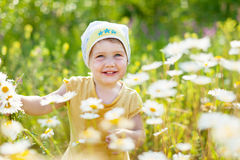Girl with camomile flowers Royalty Free Stock Photo
