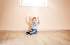Portrait of a two years old child sitting on the floor. Pretty little boy at home Royalty Free Stock Images