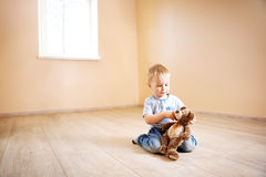 Portrait of a two years old child sitting on the floor. Pretty little boy at home Stock Image