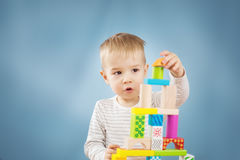 Portrait of a two years old child sitting at the table Stock Photography