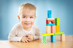 Portrait of a two years old child sitting at the table Royalty Free Stock Images