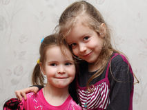 Portrait of two young adorable sisters Stock Image