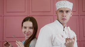 Portraits of two person in medical uniform posing with dental tools and jaw
