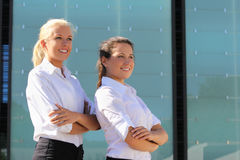 Portrait of two young attractive business women outdoor Royalty Free Stock Image