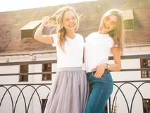 Beautiful trendy girls posing in the street stock images