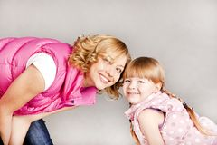 Portrait of two young beautiful girls smiling Royalty Free Stock Photo