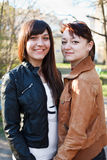 Portrait of two young beautiful women a girlfriend Stock Images