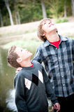 Two young boys looking up Stock Images