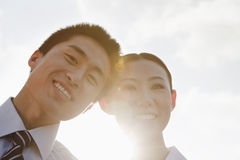 Portrait of two young business people leaning forward, close-up, brightly lit Royalty Free Stock Photos