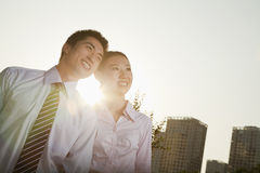 Portrait of two young business people leaning forward, close-up, brightly lit Royalty Free Stock Image