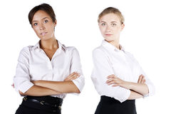 Portrait of two young businesswomen in the studio Royalty Free Stock Images