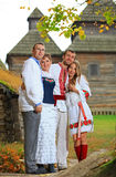 Portrait of two young couples in Ukrainian style clothing Stock Photos