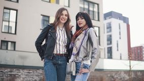 Portrait of two young fashionable girls in the spring city.  stock video footage