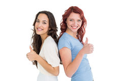Portrait of two young female friends gesturing thumbs up Royalty Free Stock Photo