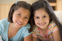 Portrait Of Two Young Girls. Smiling royalty free stock photos