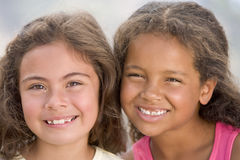 Portrait Of Two Young Girls. Smiling stock images