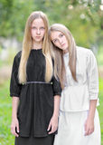 Portrait of two young girls girlfriends Royalty Free Stock Images
