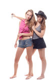 Portrait of two young girls with a gun. Shooting studio Stock Photos