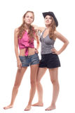 Portrait of two young girls with a gun. Shooting studio Stock Image