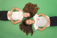 Portrait of two young girls with long hair, top view Stock Photos