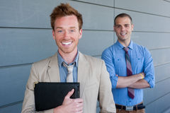 Portrait of two young handsome businessmen Stock Photos