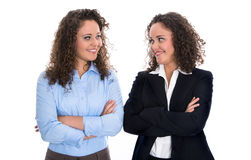 Portrait of two young isolated business woman - real twins. Royalty Free Stock Photos