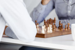 Portrait of two young man playing chess Stock Images