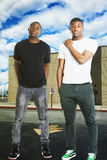 Portrait of two young men in casual wear standing on road Royalty Free Stock Photos