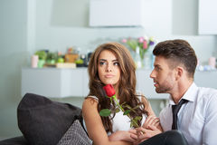 Portrait of two young people holding a rose Royalty Free Stock Images