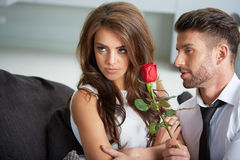 Portrait of two young people holding a rose Royalty Free Stock Image
